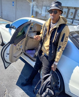 Moneybagg Yo Rests On His Maybach In A Gucci Hat Vest Hoodie Backpack Amiri Jeans And Timberland Boots