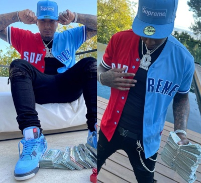 Moneybagg Yo Weairng A Supreme Light Blue 59fifty With A Supreme Dont Hate Jersey Amiri Jeans And Jordan Light Blue Sneakers
