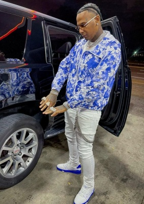 Moneybagg Yo Wearing A Louis Vuitton Blue Watercolor Jacket With A White Monogram Belt And White Blue Sneakers