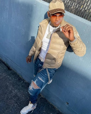 Moneybagg Yo Wearing A Louis Vuitton Hat Moncler Puffer And Nike X Bodega Sneakers