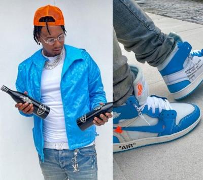 Moneybagg Yo Wearing A Louis Vuitton Windbreaker Belt And Keyring With Jordan X Off White Sneakers