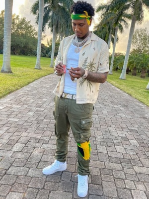 Moneybagg Yo Wearing An Amiri Cannabis Shirt With Green Cargos Air Force 1 Sneakers And Louis Vuitton Belt