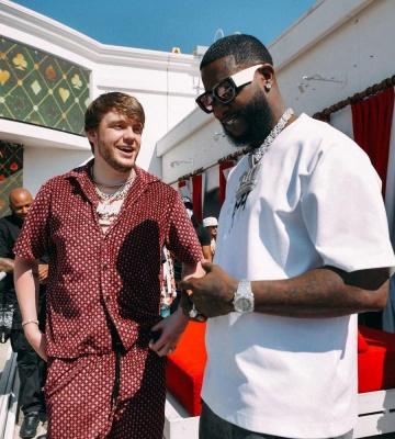 Murda Beats Wearing An Amiri Diamond Shirt And Shorts With Gucci Mane In Gucci Sunglasses
