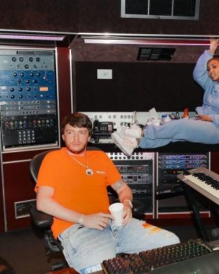 Murda Beatz Wearing A Balenciaga Orange Political T Shirt With Amiri Xplayboy Jeans And Nike Air Force 1 Sneakers