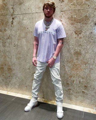 Murda Beatz Wearing A Givenchy Lavender Logo Tee And White Jeans With Louis Vuitton Sneakers