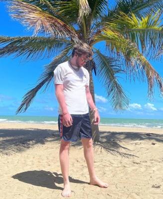Murda Beatz Wearing A Stone Island Whtie T Shirt With Gucci Navy Blue Swim Shorts