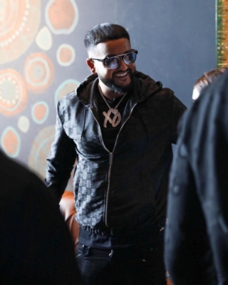 Nav Wearing A Black Givenchy Jacket And Louis Vuitton Jungle Sunglasses