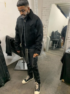 Nav Wearing A Black Wol Bomber Jacket With Rick Owens Pants And Sneakers