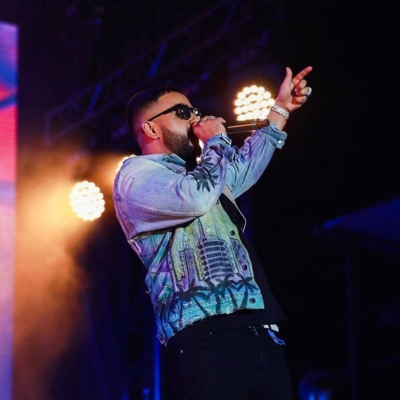 Nav Wearing An Amiri Denim Jacket At Rolling Loud