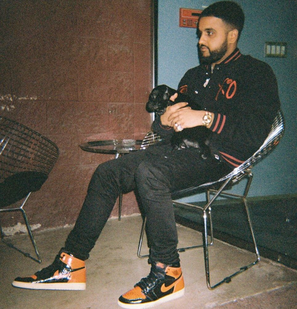 Nav With His Dog In Bape X Xo Jacket And Nike Shattered Backboard Sneakers