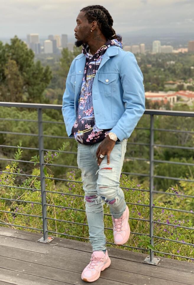 Offset Wearing A Blue Denim Jacket With A Dior Hoodie Amiri Multicolor Underpatch Jeans And Pink Dior Sneakers