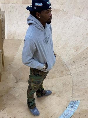 Offset Wearing A Supreme X Kaws Grey Logo Hoodie And Jordan X Kaws Grey Sneakers