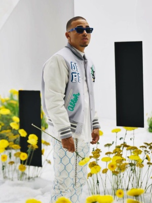 Ozuna Wearing Blue Versace Sunglasses With An Off White Varsity Jacket And White Chain Print Jeans