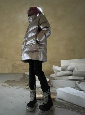 Playboi Cardi Wearing A Rick Owens Silver Puffer And Black High Boots