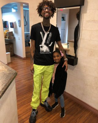 Pnb Rock Instagram Post Wearing A Black Louis Vuitton Peach And Love T Shirt And Yellow Off White Arrow Stripe Track Pants
