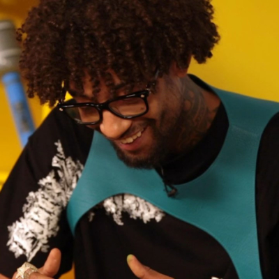 Pnb Rock Wearing A Black Louis Vuitton Dorthy T Shirt And Blue Louis Vuitton Cut Out Vest