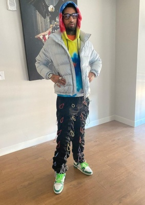 Pnb Rock Wearing A Dior Silver Puffer With A Tie Dye Hoodie Black Multicolor Bungee Pants And Louis Vuitton Whtie Green Sneaker