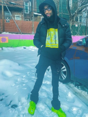Pnb Rock Wearing A Gucci Puffer With A Heron Preston Hoodie And Balenciaga Track Sneakers