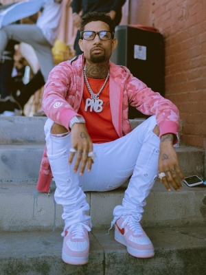 Pnb Rock Wearing A Pink Bape Hoodie With A Red Off White T Shirt White Jeans And Nike White Pink Air Force 1s