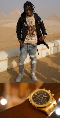 Polo G In Cairo Wearing A Burberry Jacket Burberry Deer Tee Burberry Belt Audemars Watch Amiri Jeans And Burberry Sneakers