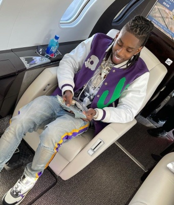 Polo G Wearing A Palm Angels Varsity Jacket With Amiri Jeans And Dior B22 Sneakers