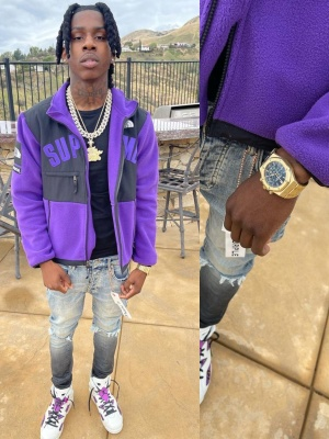 Polo G Wearing A Supreme X The North Face Jacket With An Audemars Watch Purple Brand Jeans And Jordan Sneakers