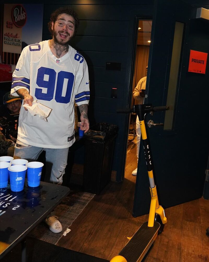 Post Malone Wearing A Dallas Cowboys Jersey And Vans With His Bird Scooter