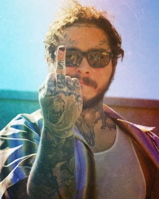 Post Malone Wearing Arnette Sunglasses With A Purple And Brown Stried Shirt
