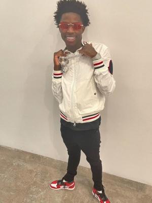 Quando Rondo Wearing A Moncler Bomber Jacket With Split Jordan 1s
