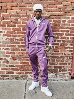 Quando Rondo Wearing A Palm Angles Purple Tracksuit And White Air Force 1 Sneakers
