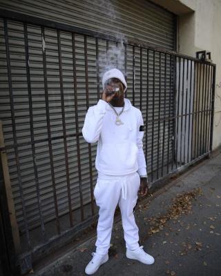 Quanod Rondo Smokes In All White Stone Island Fit