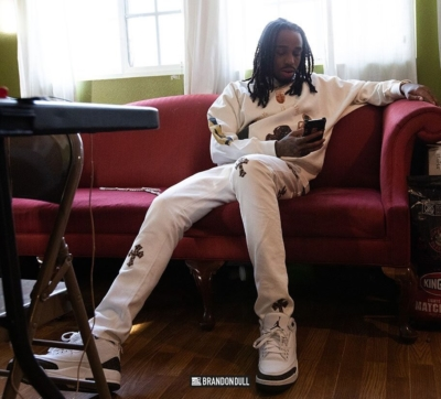 Quavo Relaxes In Jesus Is King Sweatshirt Chrome Hearts Pants And Jordan 3 Mocha Sneakers