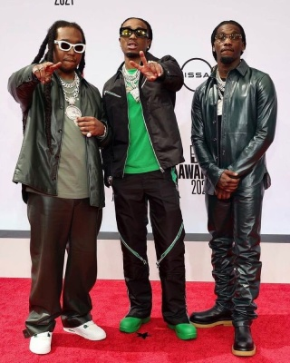 Quavo Wearing A Bottege Veneta Black And Green Zip Jacket And Pants With Green Boots