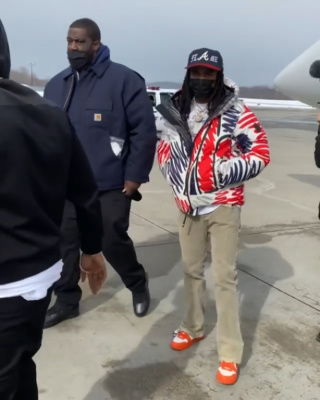 Quavo Wearing A Moncler Grenoble Logo Print Puffer Jacket With Louis Vuitton White Orange Sneakrs