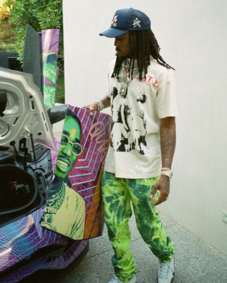 Quavo Wearing A Raf Simons Tee Laropa Trucker Hat And Jordan 14s