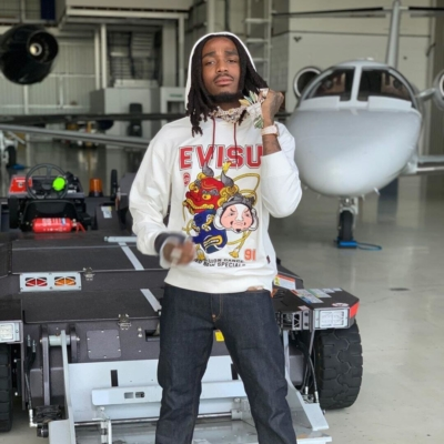 Quavo Wearing An Evisu White Hoodie And Evisu Daicock Print Jeans