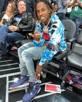Rich The Kid At An Nba Game Wearing An Amiri Hoodie With Jordan 4s