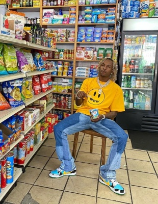 Rich The Kid Relaxes In A Drew House Tee Gallery Dept Flared Jeans And Nike Ben And Jerry Dunks
