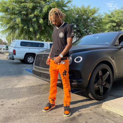 Rich The Kid Shows Off His Chrome Hearts Fit Beside His Bentley