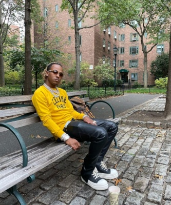 Rich The Kid Wearing A Yellow Black Celine Sweatshirt With Black Rick Ownes Pants And Sneakers And A Louis Vuitton Backpack