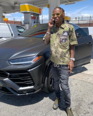 Rich The Kid Wearinga Burberry Shirt With Dolce Belt Jeans And Sneakers