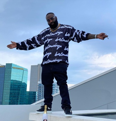 Rick Ross Wearing A Balenciaga Logo Sweater With Alexander Mcqueen Sneakers
