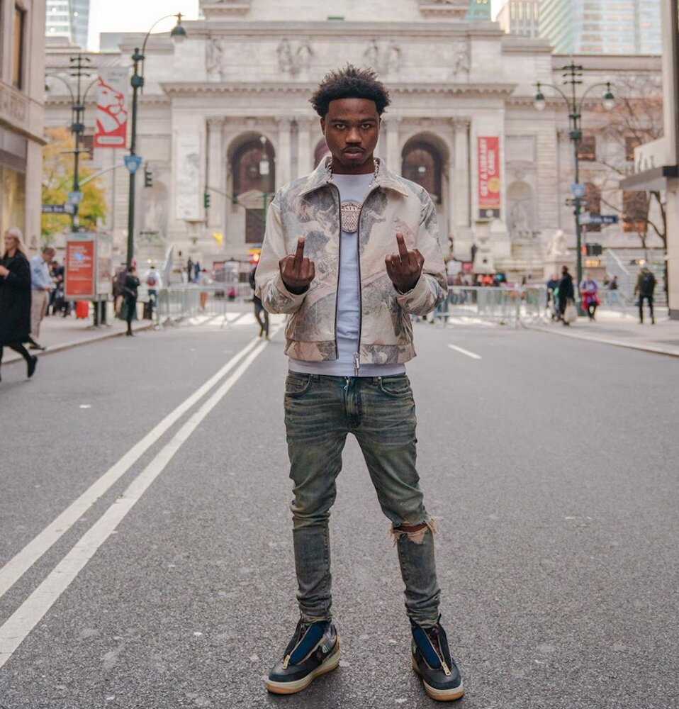 Roddy Ricch Poses In Front Of The Nyc Library In A Rhude Jacket And Nike X Travis Scotts