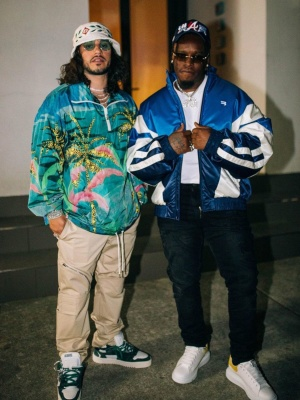 Russ Wearing A Casablanca Buket Hat With A Celine Windbreaker And Off White Sneakrs