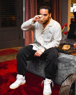 Russ Wearing A Rhude Striped Shirt With Dolce Gabbana Cargo Jeans And Lanvin Sneakers