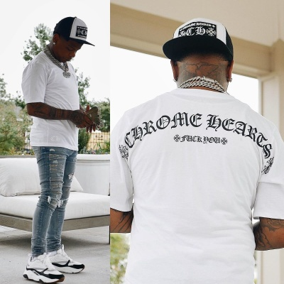 Rylo Rodriguez Wearing A Chrome Hearts Trucker Hat And T Shirt With Amiri Jeans And Dior Sneakers