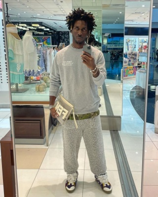 Saint Jhn Wearing A Burberry Sweatshirt With A Fendi Mesh Pouch Sweatpants And Lanvin Sneakers