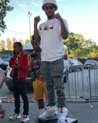 Slim Jxmmi Wearing A Maho Beach T Shirt With Amiri Jeans And Nike Parachute Sneakers