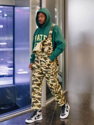Stefon Diggs Wearing A Bape X Carhartt Overalls With A Pleasures Hoodie And Jordan Sneakers