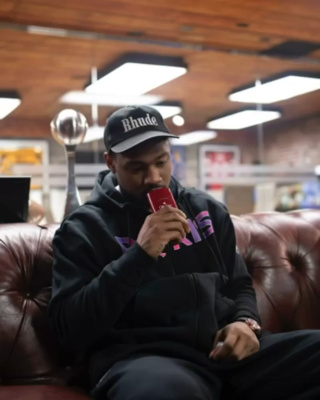 Stefon Diggs Wearing A Jordan X Psg Hoodie With A Rhude Hat
